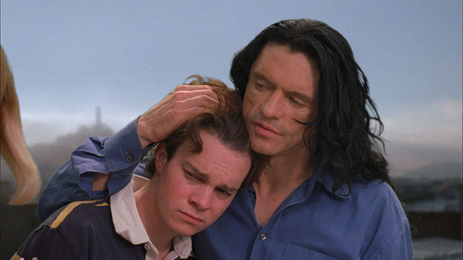 Johnny (Tommy Wiseau) gives Denny (Philip Haldiman) some neighbourly advice