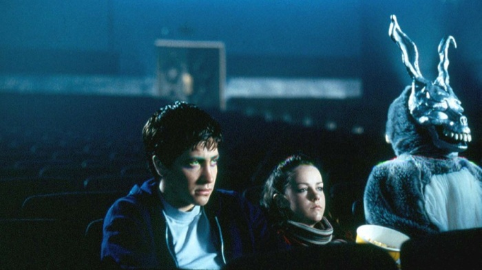 Donnie (Jake Gyllenhaal), Gretchen (Jena Malone) and Frank (James Duval) take in a movie.