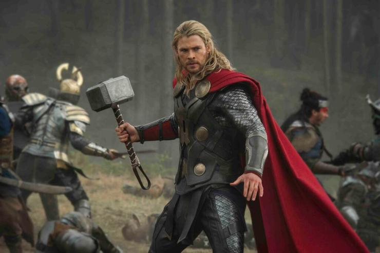 Thor (Chris Hemsworth( flashes his famous weapon